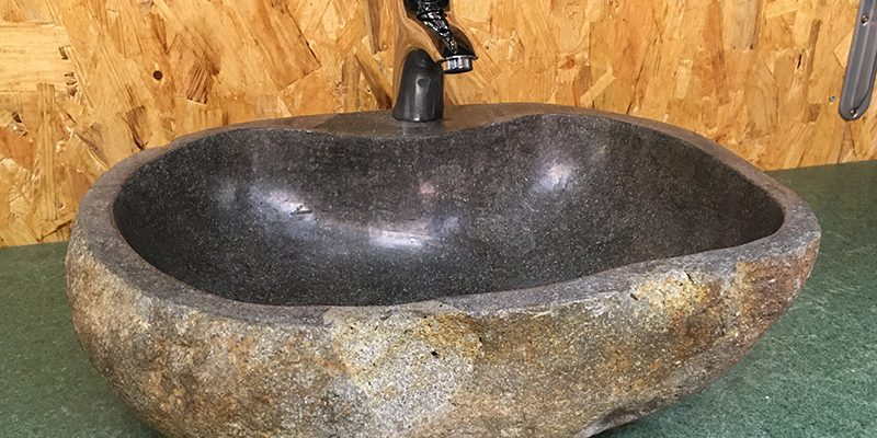 River stone sink with a recess for a water tap